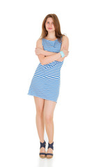 girl on a white background in a short striped dress