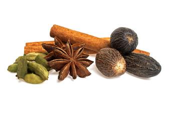 Anise, cardamom, nutmeg and cinnamon sticks on a white backgroun