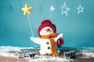 Small snowman with star and gifts