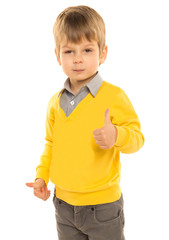 "little boy in a yellow sweater shows ""everything is fine"""