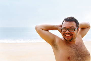 Very happy young man rejoices vacation
