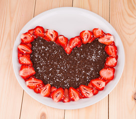 Chocolate heart into strawberry frame.