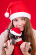 Teenager with dog in Christmas portrait