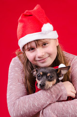 Child girl with dog in Christmas portrait