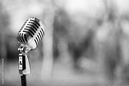 Silver vintage microphone in the studio on blured background