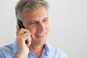 Mature Man Talking On Cellphone