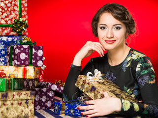 gorgeous young woman portrait with holiday presents