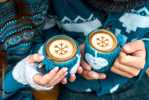 Couple with coffee cups in winter - 74011072