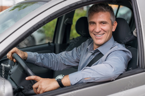 Leinwanddruck Bild Happy Businessman Driving Car