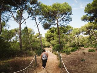 Woman walking in mediterranean forest