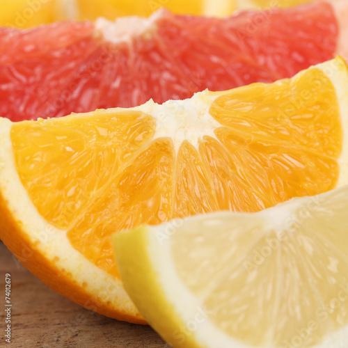 canvas print picture Nahaufnahme geschnittene Orange, Zitrone und Grapefruit Früchte