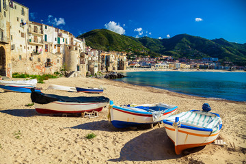 Old beach in Cefalu with fishing boats