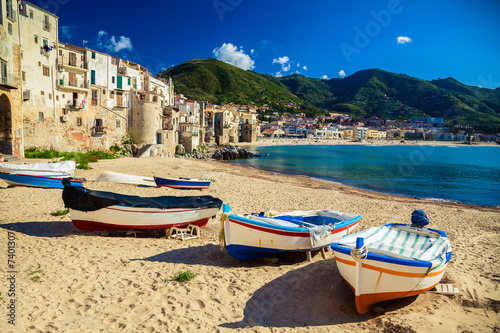 City on the water Old beach in Cefalu with fishing boats