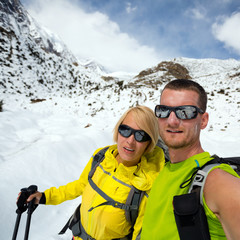 Couple hikers selfie portrait expedition in winter mountains