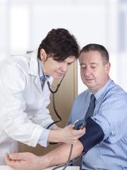 Doctor measures the blood pressure in patients