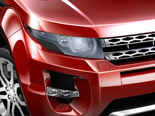 Headlamp detail of compact red SUV