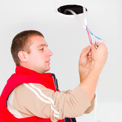 Electrician working with wires and other utensils
