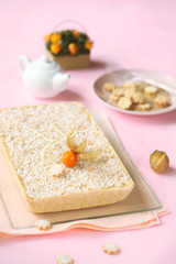 Pear and Coconut Tart decorated with Physalis