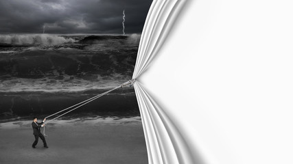 businessman pulling open blank curtain covered dark stormy ocean
