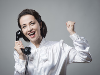 Cheerful business woman on the phone