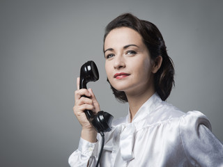 Confident vintage secretary on the phone