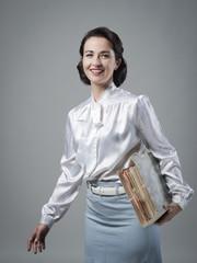 Retro secretary holding documents in a folder