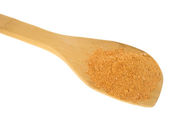 Portion of taco seasoning on a wood spoon