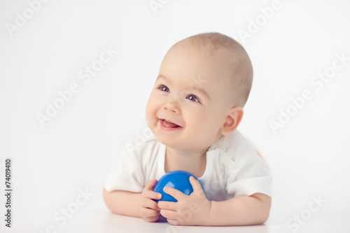 Baby with a blue toy - 74019410