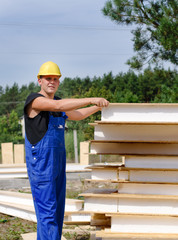 Builder selecting an insulated wall panel