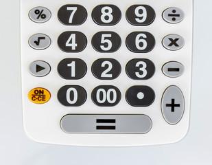 Closeup of a white calculator keyboard