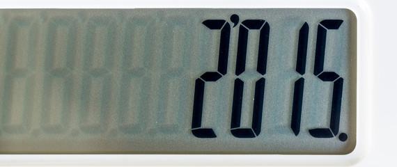 Close up photo of white color calculator put on black leather su