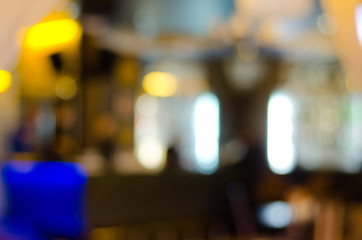 Blurred interior of a location for food and drinks