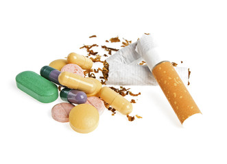 Broken cigarette and pills isolated on white background