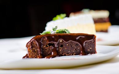Slice of Sweet Chocolate Cake with Chocolate Syrup