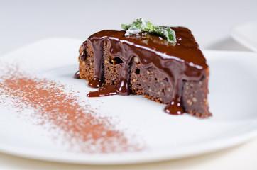 Freshly baked chocolate tart with sauce