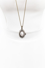 Vintage pearl necklace on white manequin