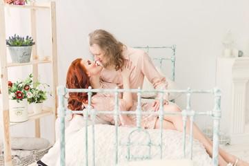 Tender kiss loving couple in bright vintage room