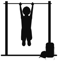 boy hanging from bars in playground