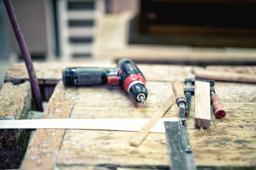 Cordless screwdriver and carpenter tools in wood industry