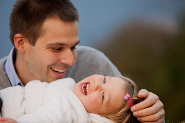 happiness is a father bewitched by his little daughter