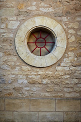 Round window on a stone wall