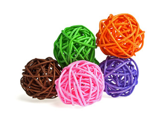 Colored wicker bamboo balls on a white background
