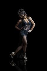 elegant beautiful woman latin dancer performing on black backgro
