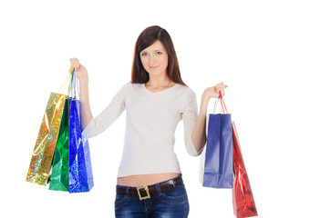 Pretty brunette with shopping bags over white