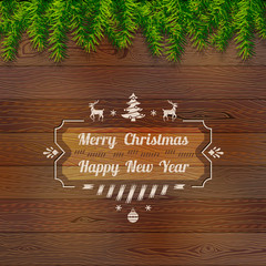 Wooden background with top pine branches. Christmas template
