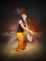 young woman with dreadlocks ethnic style playing drum percussion