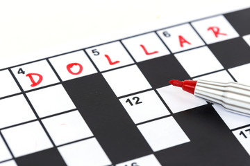 Close up red marker on Crossword - Dollar