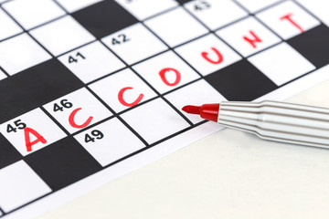 Close up red marker on Crossword - Account