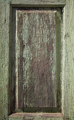old peeling paint over wooden panel