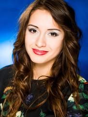 lovely brunet portrait at blue background